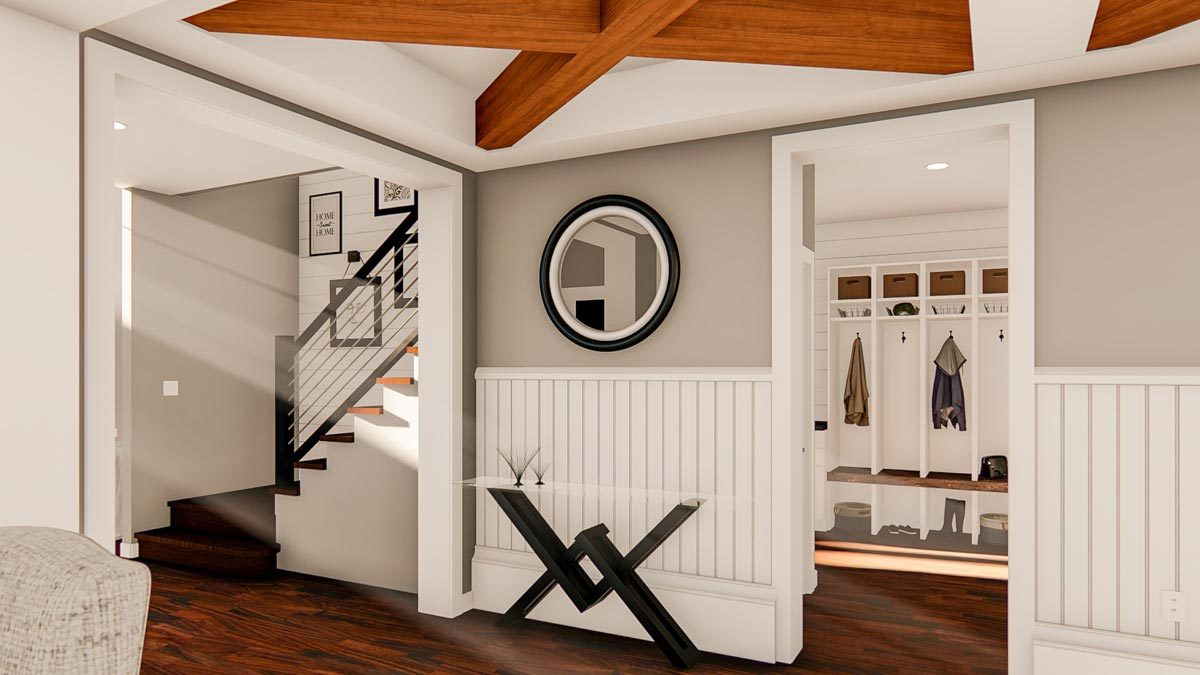 View of the staircase and the mudroom from the foyer with beamed ceiling.