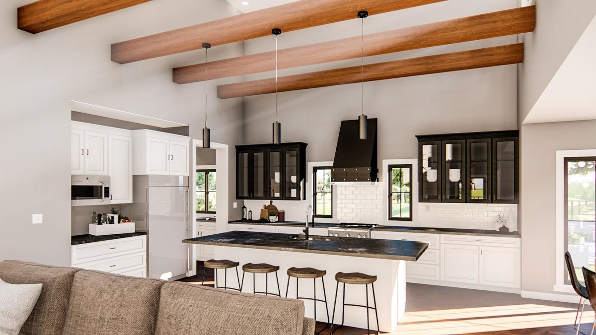 The kitchen is equipped with white and glass front cabinets, black marble countertops, stainless steel appliances, and a breakfast island bar.
