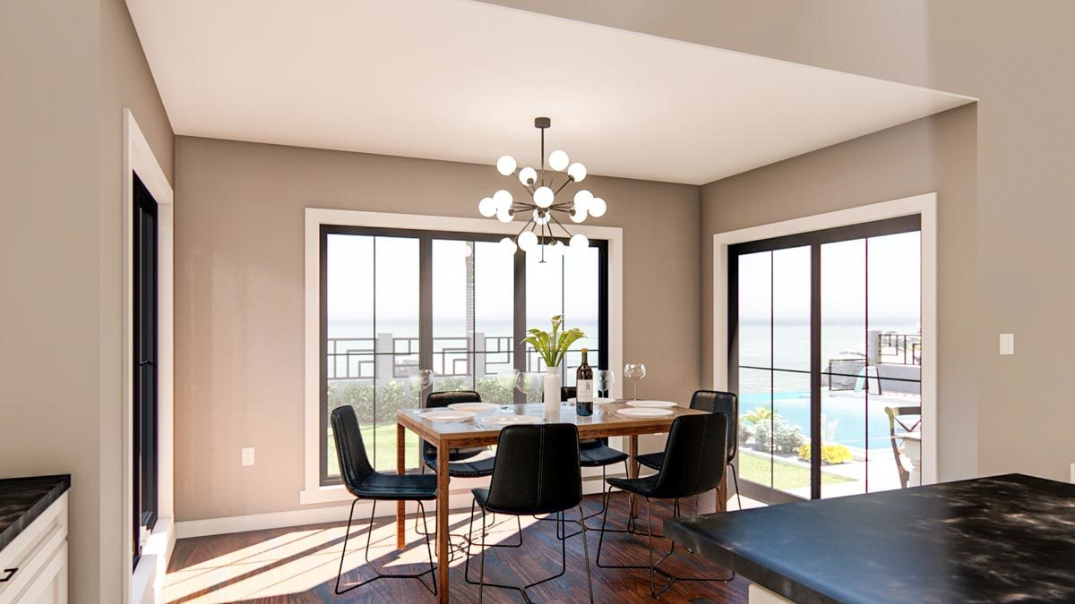 Breakfast nook with a wooden dining table, black modern chairs, and a sputnik chandelier.