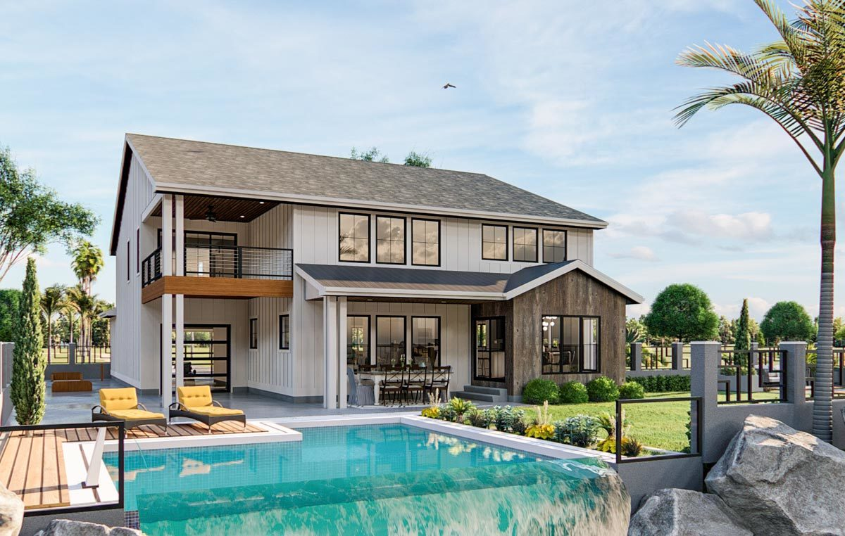 Rear exterior view showcasing the outdoor dining and a swimming pool with a wooden deck.
