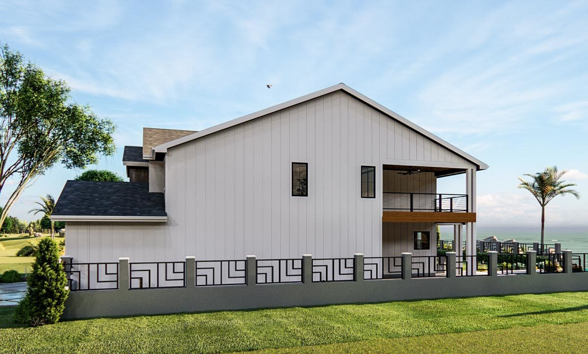 Right side view showing the upper balcony and a concrete fence surrounding the house.