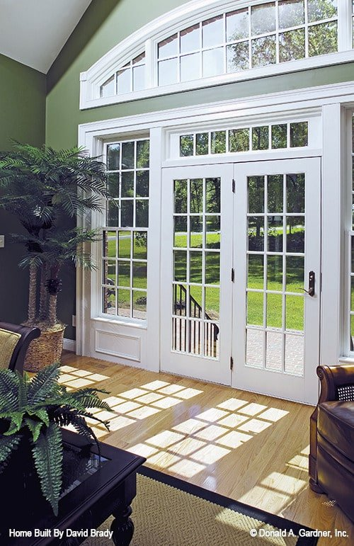A white framed door in the living room leads out to the rear deck.
