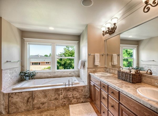 Dual sink vanity and a drop-in bathtub complete the primary bathroom.