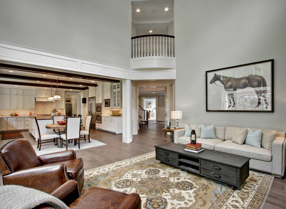 An open layout view showing the living room, eat-in kitchen, and foyer.
