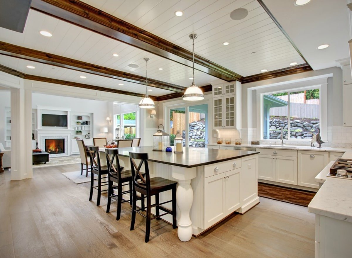 Recessed ceiling lights along with a pair of glass dome pendants illuminate the kitchen.