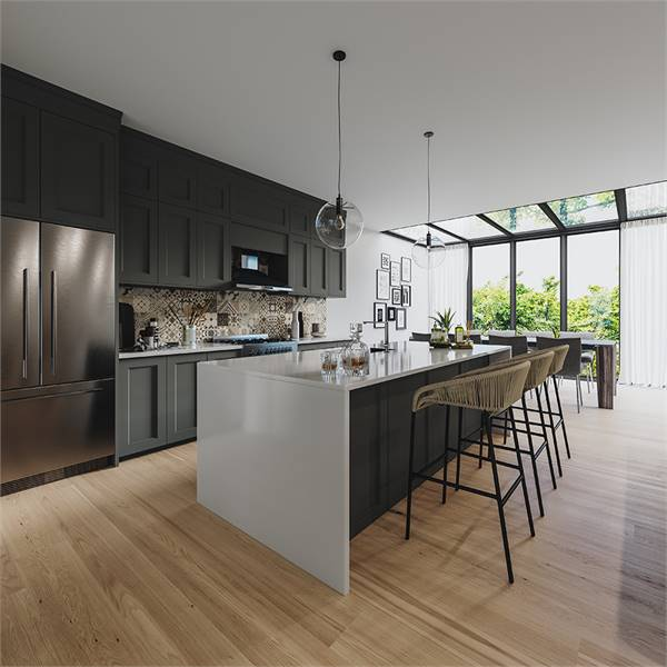 The kitchen is equipped with custom gray cabinets, marble countertops, stainless steel appliances, and a large center island. The dining area across doubles as a sunroom.
