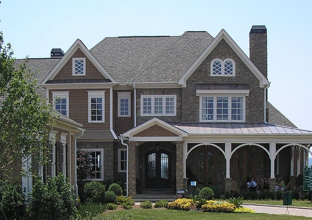 Home entry showcasing decorative arches, stone accents, and a french front door.