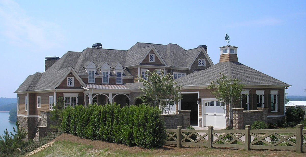 A farther view shows the magnificent lake scenery surrounding the house.