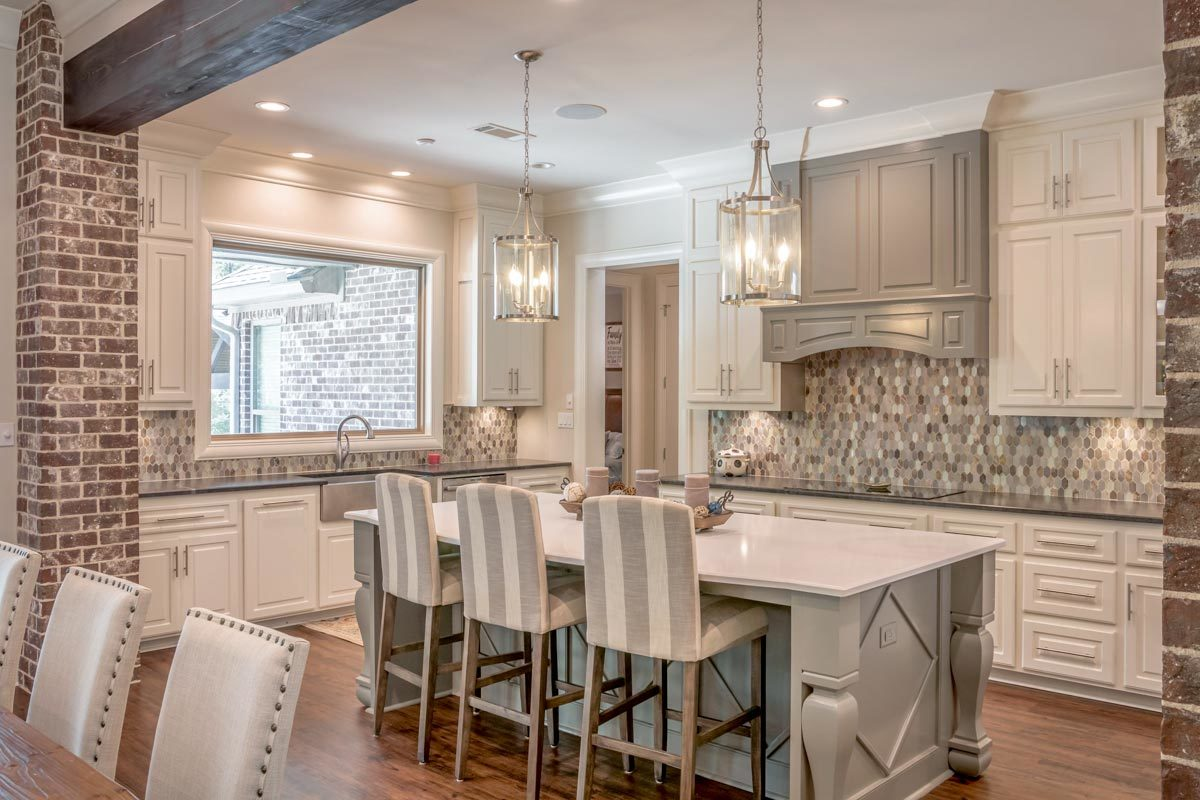 Gray striped counter chairs complement the marble top center island.