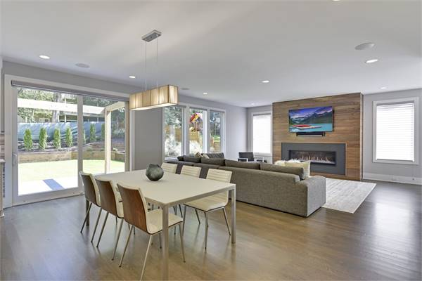 An open space with a hardwood floor shared by the living room and dining area.