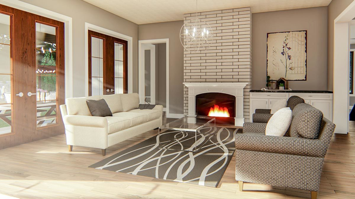 The living room has white sectional, patterned armchairs, glass top coffee table, and a brick fireplace.