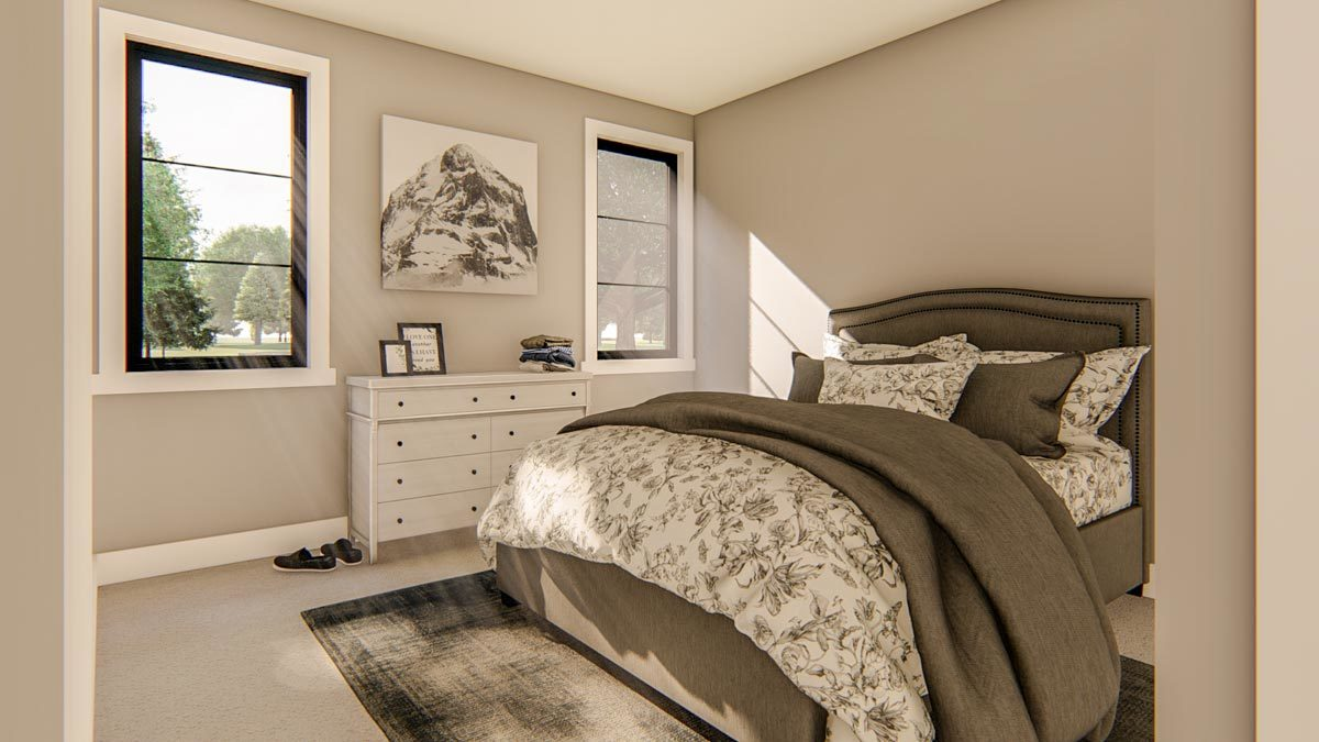 Another bedroom with a cozy gray bed, distressed area rug, and a white dresser adorned with a landscape painting.