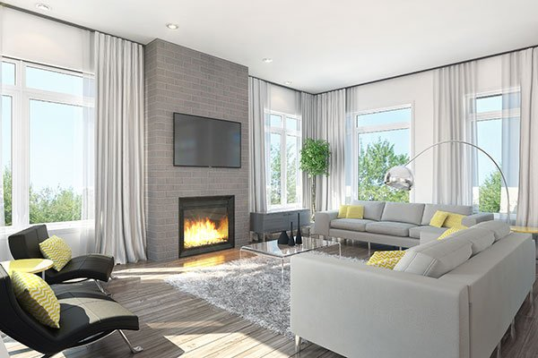 Living room with a glass-enclosed fireplace, a wall-mounted TV, gray sofas, leather lounge chairs, glass top coffee table, and a shaggy area rug.
