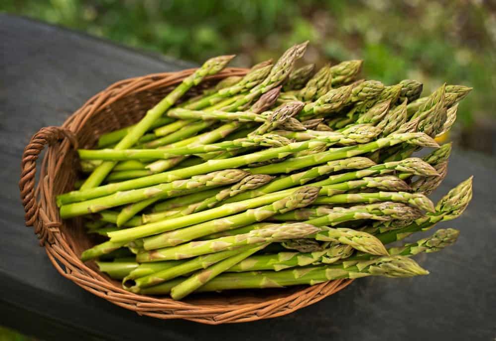 Asparagus in a rattan basket.