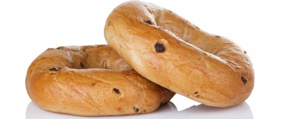 A close look at a couple of chocolate chip bagels.