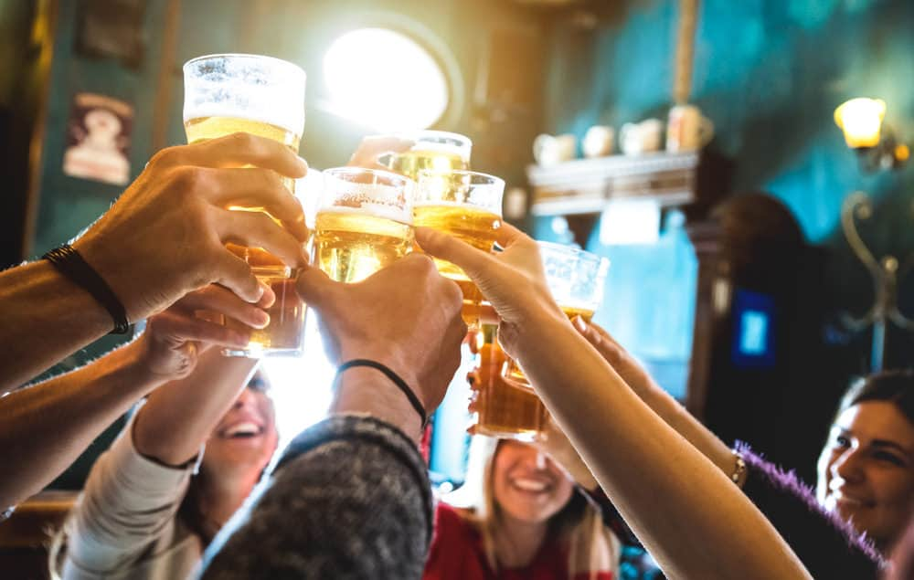 Group of people drinking beer in a pub.