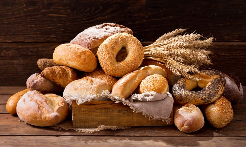 Various types of breads against a rustic background.