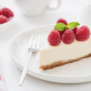 A slice of cheesecake with berries on top.