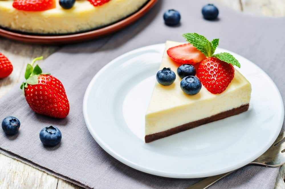 A slice of Ricotta Cheesecake with fruits.
