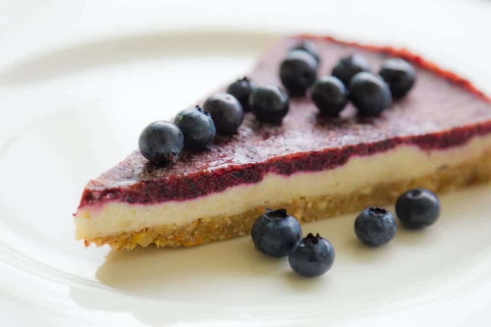 A slice of Vegan Cheesecake on a plate.