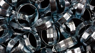 A close look at a bunch of stainless steel hose clamps.