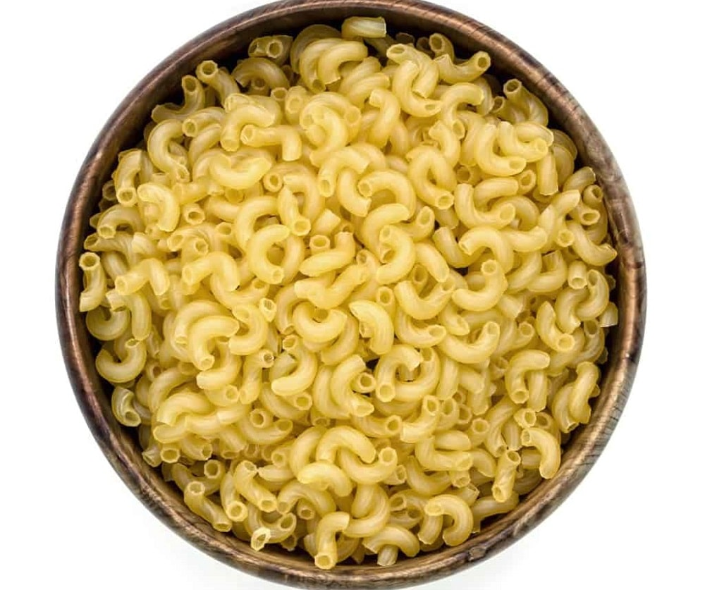 A wooden bowl filled with macaroni.