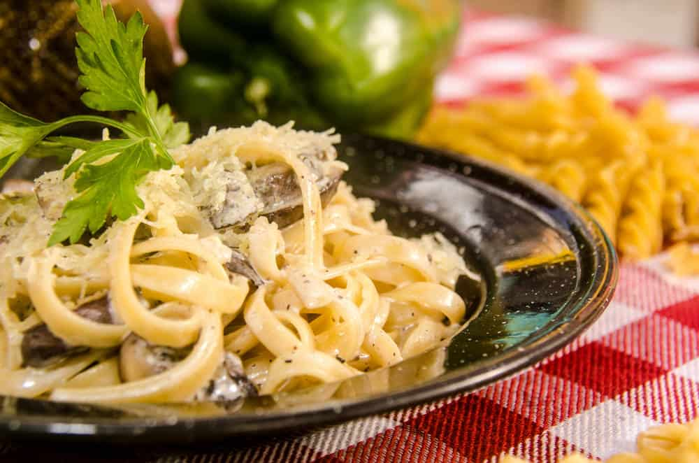 A freshly cooked Fettucini pasta with wild mushrooms.