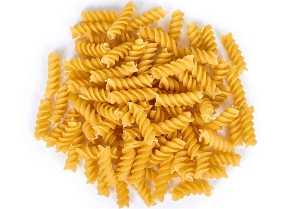 A close look at a bunch of uncooked fusilli pasta.