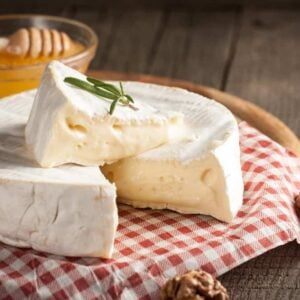 A sliced wheel of brie cheese.