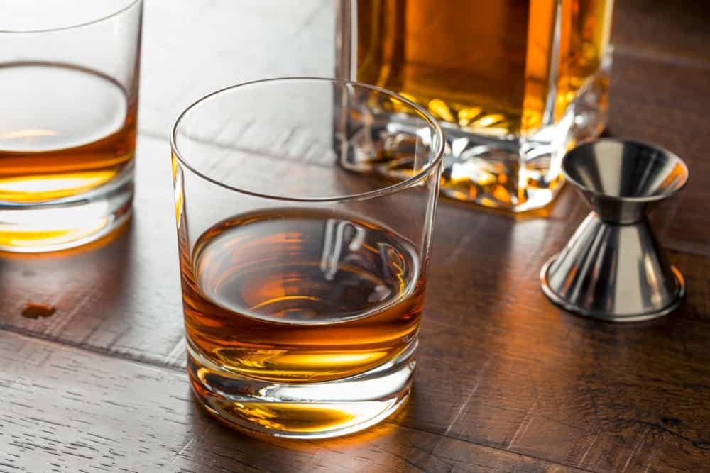 A glass of corn whiskey neat.
