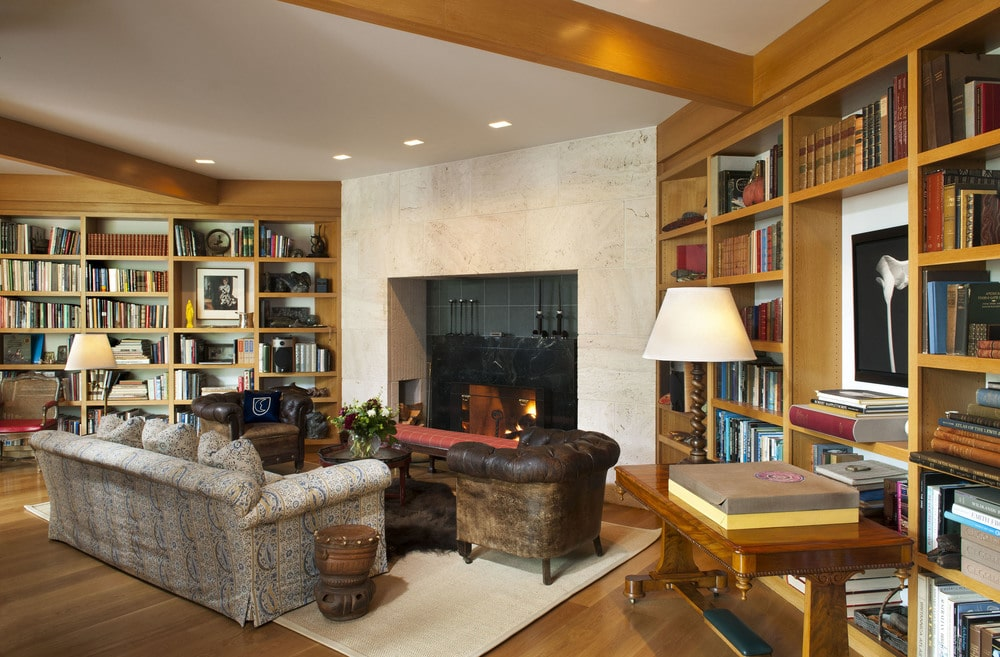 This is the library with a couple of large wooden built-in bookshelves on the walls flanking the fireplace across from the sofa. Image courtesy of Toptenrealestatedeals.com.