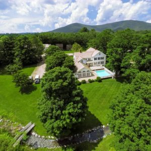 This is an aerial view of the estate showing the three structures. The main house has a large pool at the back and on the far side you can see the guest house and cabin. Image courtesy of Toptenrealestatedeals.com.
