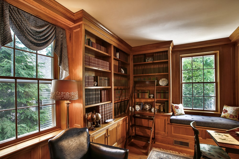 This is the private study of the main house. It has dark wooden built-in bookshelves lining the walls along with a built-in bench under the window. Image courtesy of Toptenrealestatedeals.com.