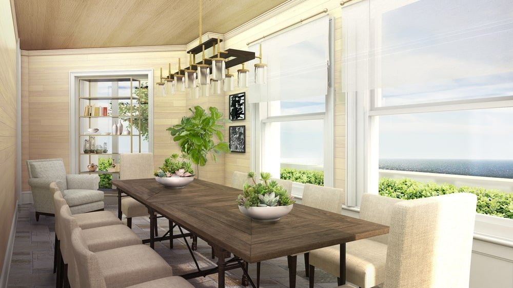 The large dark wooden dining table of this dining room stand out against the bright beige walls and tall windows that bring in natural lights. Image courtesy of Toptenrealestatedeals.com.