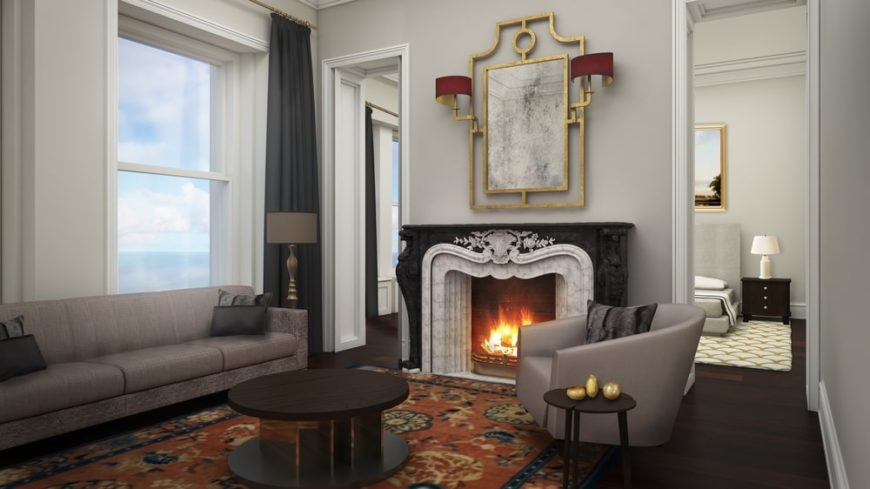 This is a look at the living room just outside the primary bedroom. This area has a sofa set warmed by the elegant fireplace with a black and white mantle topped with a painting. Image courtesy of Toptenrealestatedeals.com.