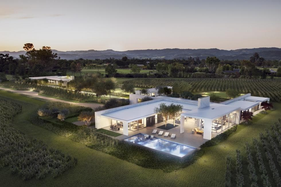 Aerial view of the home showcasing its magnificent exterior and lush lawn area.