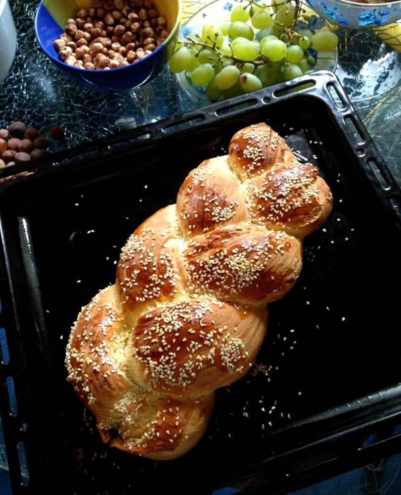 Zopf bread on a black tray.