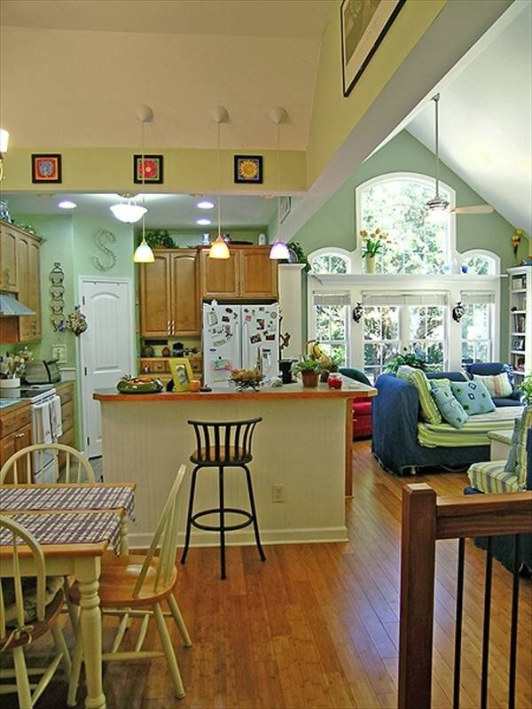 An open layout view showing the dining area, kitchen, and living room.