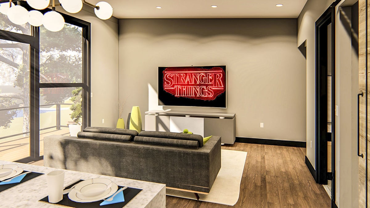The living room has a cozy gray sofa and a flatscreen TV fixed above the modern console table.