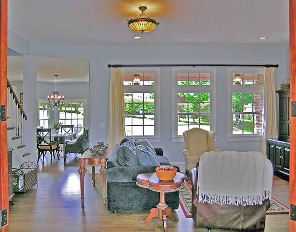 A farther view of the living room shows the dining area ahead.