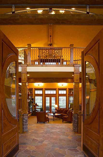 The double entry door opens to the living room defined by wooden columns.