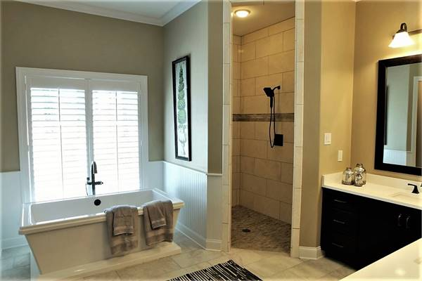 Walk-in shower and a freestanding tub complete the primary bathroom.