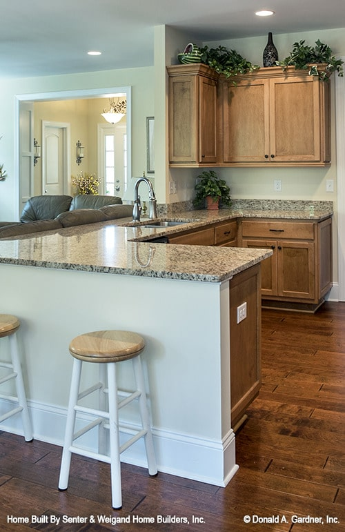 Round bar stools complement well with the kitchen peninsula.