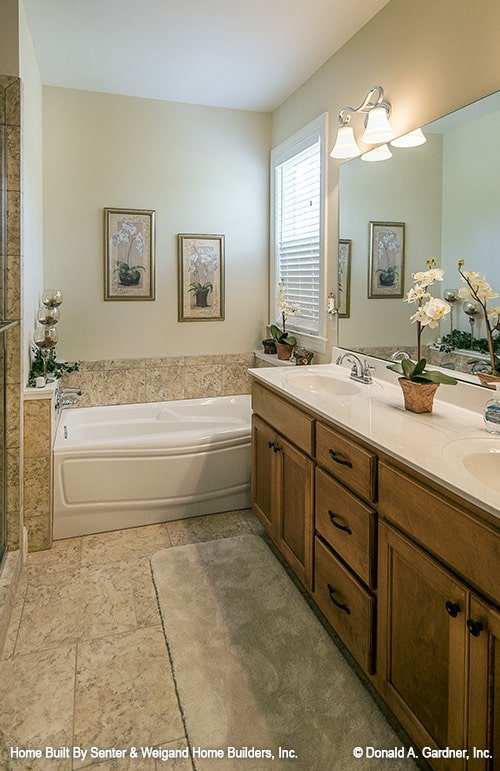 Primary bathroom with a deep soaking tub and a dual sink vanity.