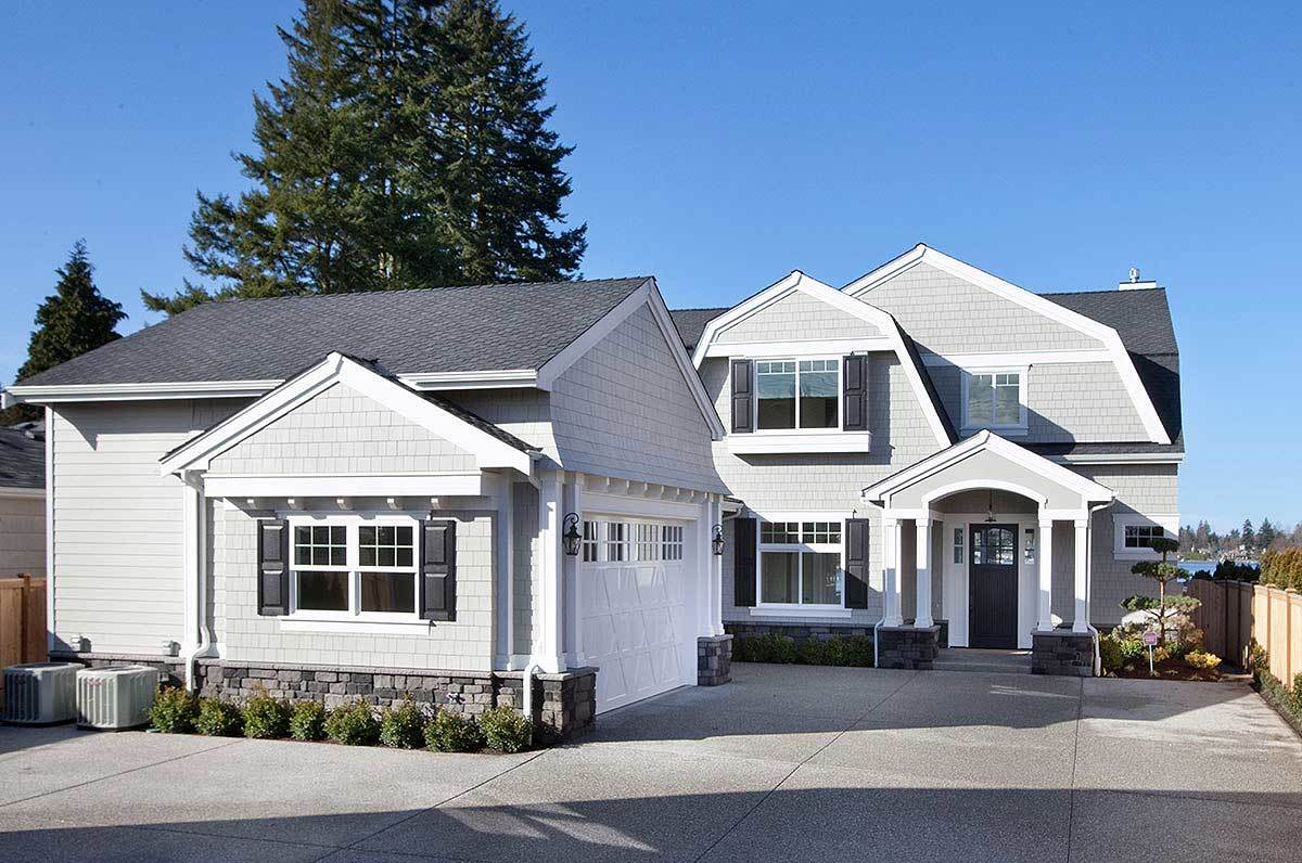 3-Bedroom Two-Story Cape Cod Home with Gambrel Roofs and Open Floor Plan
