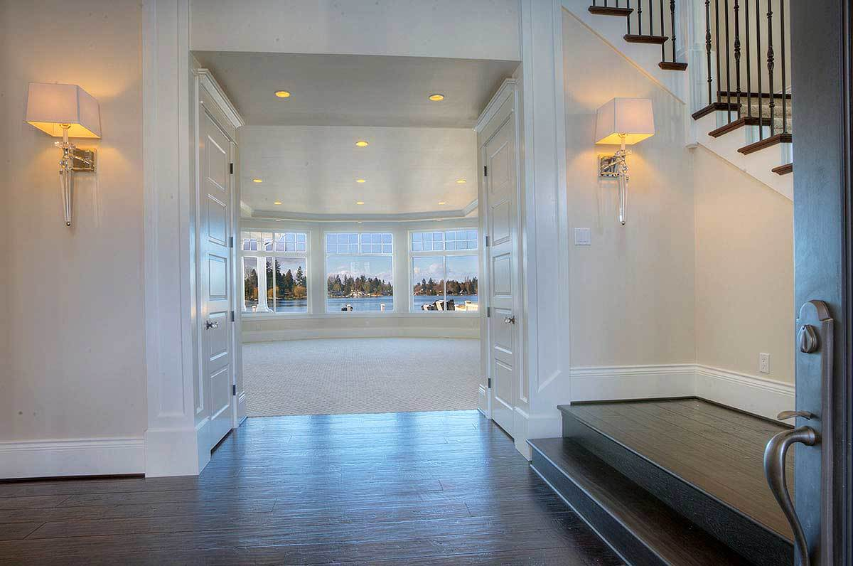 The foyer opens to a spacious great room with a bay window.