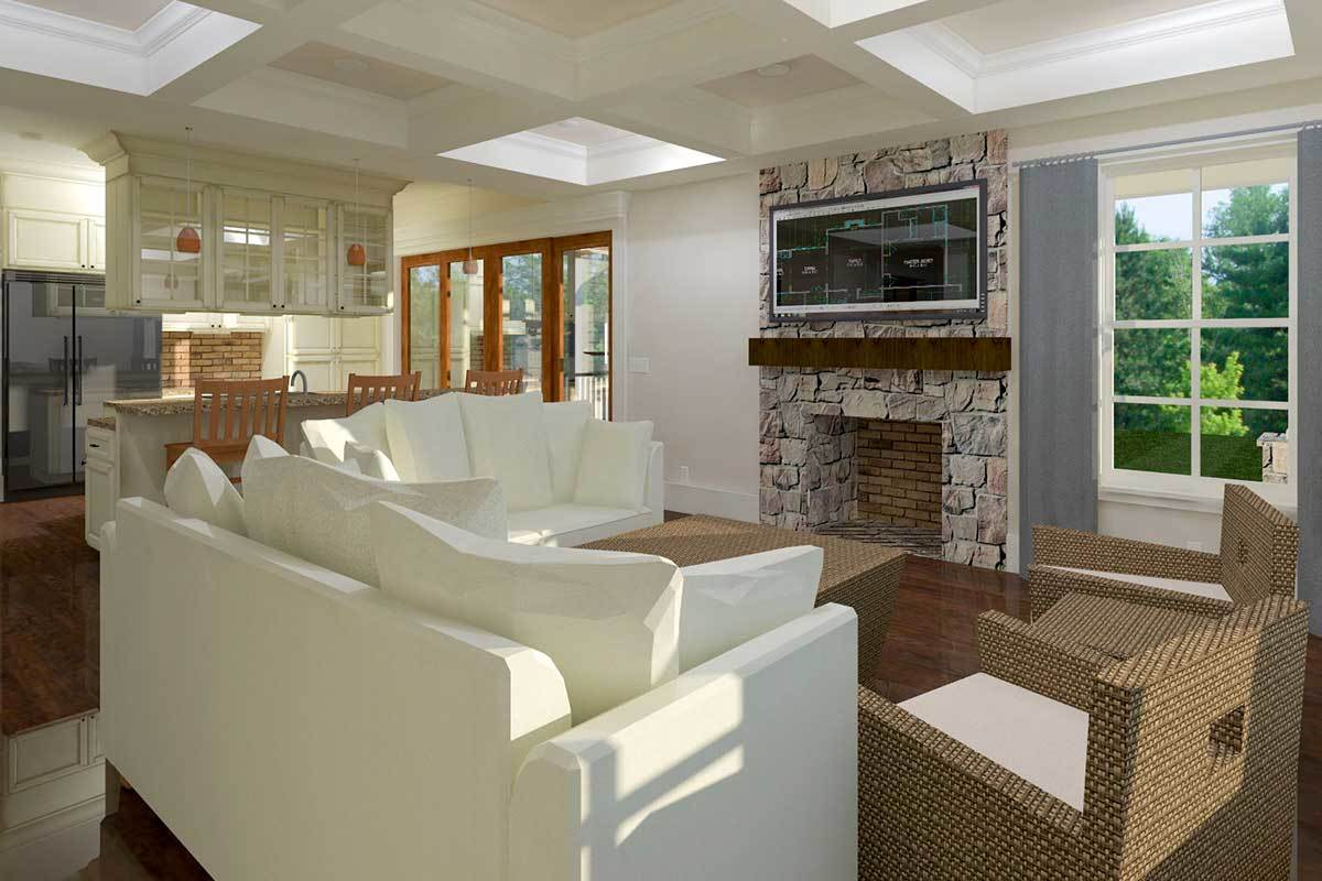 The living room has white sofas, wicker armchairs, and a stone fireplace with a TV on top.