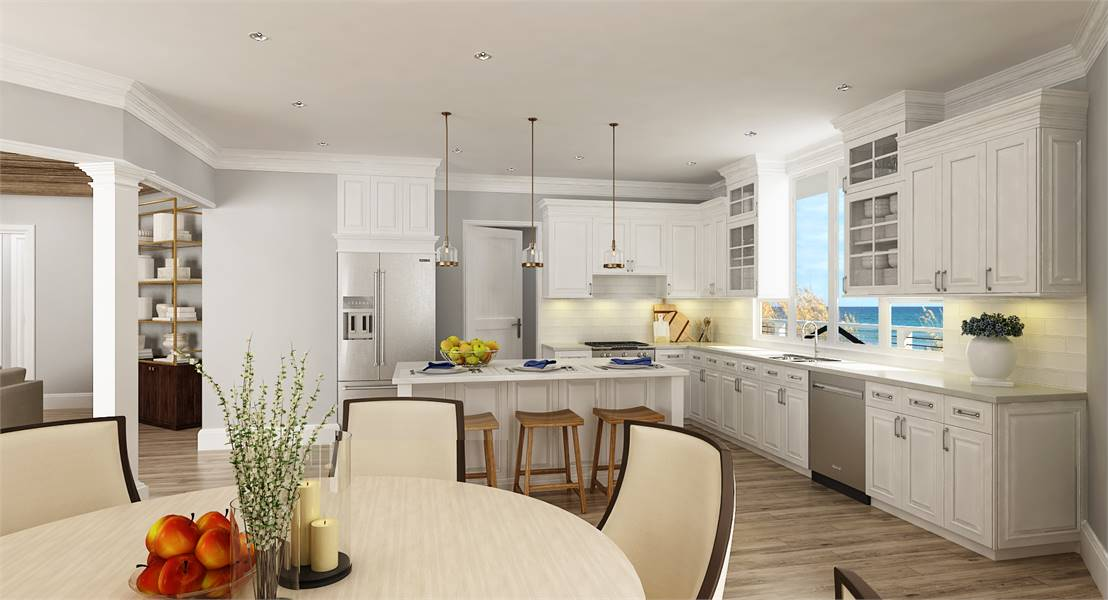 Eat-in kitchen with white cabinetry, slate appliances, subway tile backsplash, and a marble top island.