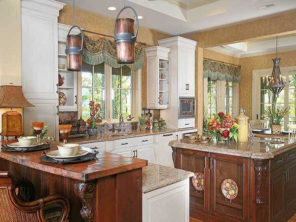 The kitchen is equipped with granite countertops, white cabinets, center island, and a two-tier peninsula.