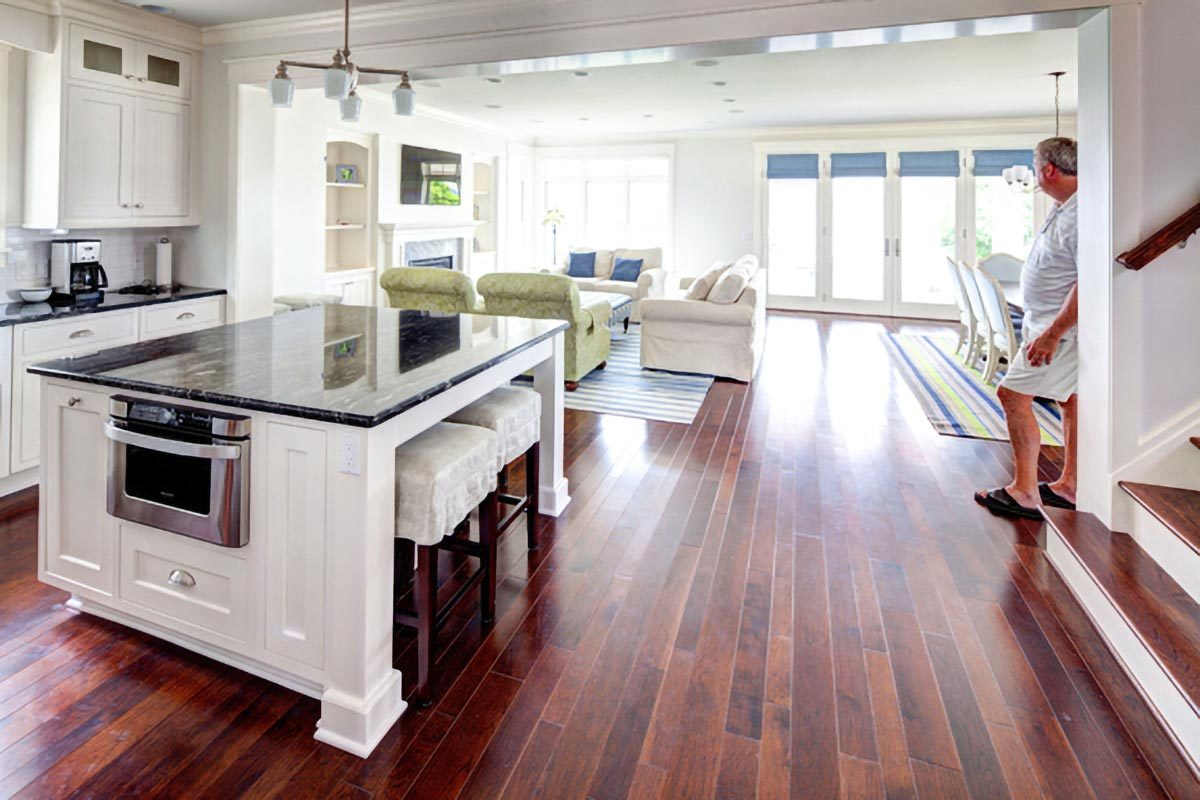 An open layout view showing the kitchen, dining area, and living room.